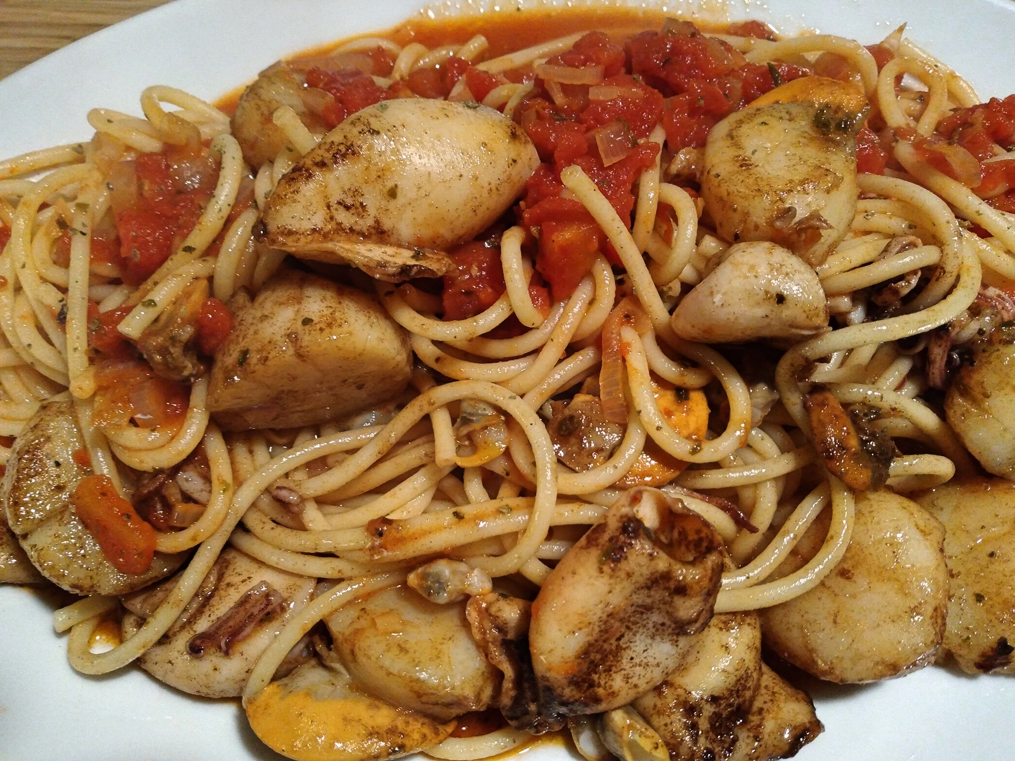 Pasta with clams, scallops and squid